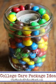 The care packages don't need to be anything fancy, but just a little something fun and usable to let her know you are thinking about her. What's more fun and usable than M&M's and money?