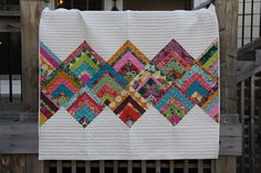By now, you've certainly seen a number of great tutorials like this phenomenal GO! Qube Lap Quilt by our guest blogger Erin Burke Harris of House on Hill Road. Erin, mother of two teenage daughters and wife to Fatty (it's okay ... trust me), lives in Kentucky along with their beloved dog and cat. Even with a busy family life, Erin manages to carve out time every week for her sewing and quilting projects.