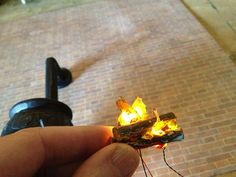 How to: Fairy Wood Stove ... pinned for specific steps on creating the burning fire and adding lighting - for the dollhouse fireplace