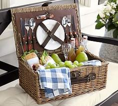 Woven of textural natural rattan, this classic basket includes everything you need for a picnic – plus plenty of room for food and wine. Lined with cotton canvas and filled with two wine glasses, two plates, flatware and a wine opener, it makes a perfect gift for a summer wedding. | Rattan Picnic Basket for 2 via @potterybarn