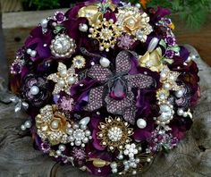 Plum wedding bouquet made of antique brooches... These are cool, I'd prefer less gold though