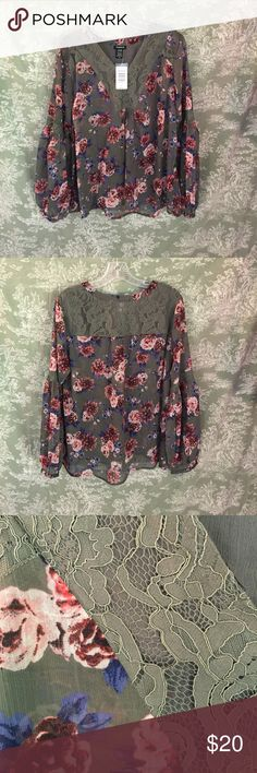 NWT Torrid blouse in gray floral Lovely peasant style blouse with lace neck and yoke in gray/ pink floral print. V neck with beautiful sleeve detail. This is a Torrid size 00 torrid Tops Blouses