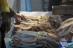 Buying a dried squid from a street vendor, South Korea
