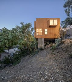 Brother and Sister cantilevered homes by Anonymous Architects