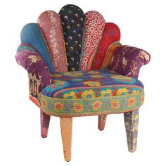 Crafted of mango wood and upholstered in vintaged kantha cloth, this eye-catching accent chair features a peacock-inspired silhouette. Pair it with a luxe sh...