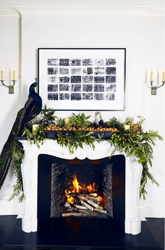 21 Christmas Mantle Garland Ideas You'll Love Christmas Mantel Garland, Mantle Garland, Christmas Mantels, Noel Christmas, Christmas Decorations, Holiday Decorating, Peacock Christmas, Fireplace Decorations, Bohemian Christmas
