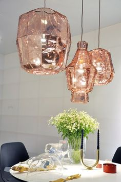 These rose gold light fixtures are stunning. I want these for my dining room!!
