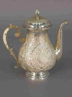 Egyptian Sterling Tea Pot | Found on liveauctioneers.com