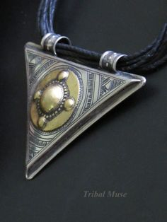 This vintage African Tuareg Tribal necklace was handcrafted in silver and brass in the mid 1900's.
