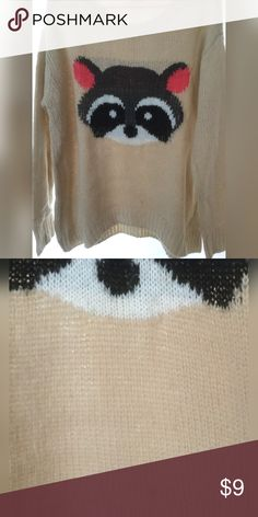 Rewind Racoon Sweater Beige sweater with grey, black, and pink racoon.  It has a little discoloration in color at the lower front in the middle (see pics).  Price takes that into consideration.   Worn once 100% Acrylic.  Size Junior XL. Rewind Sweaters Crew & Scoop Necks