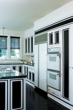 Black white kitchen. White appliances, black counters, black glossy floors. http://cococozy.com
