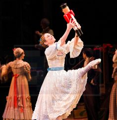 Iohna Loots as Clara with her nutcracker in Act 1 of the Royal Ballet's Nutcracker. Photo by Elliott Franks