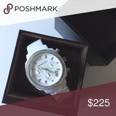 Michael Kors White Watch Gorgeous white watch by Michael Kors. Only worn once. In new / perfect condition. It does need a new battery. *Will ship with original box, original tag, and extra links. Michael Kors Accessories Watches