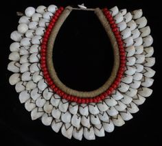 Breast shell and red bead extravagant  necklace by ubudexotica