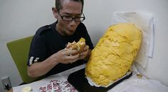 Man Orders Whopper with 1,000 Slices of Cheese (Video)