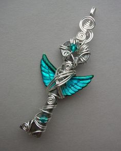 Angel Winged Key Pendant -- Turquoise Inked Small Feathered Winged Antique Key with Swarovski Crystals, Silver Wire. $55.00, via Etsy.