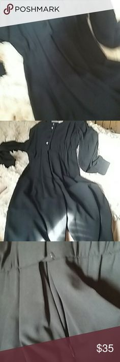 Black one-piece jumpsuit with black sheer sleeves Elegant by itself or accessorize with jewlery.  It says one size but is actually a size 8. Liz Claiborne Other