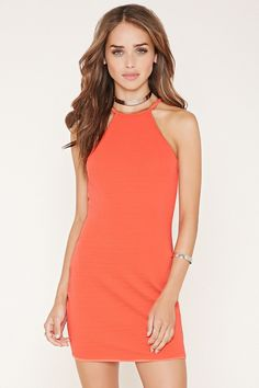 In a textured knit, this cami dress features a bodycon fit, a mini length, and a high square neckline.