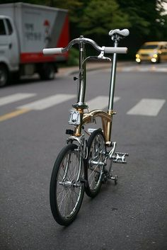 This is a  ridiculously modified Brompton Folding Bicycle from Korea! I'm sure it rides as well as it looks. - Ariel