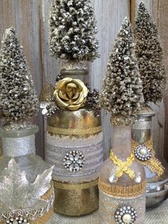 Vintage Style Gold altered Bottle with glitter bottle brush tree and metal flowers and rhinestone Retro Christmas Decorations, Christmas Centerpieces, Holiday Decor, Farmhouse Christmas Decor, Rustic Christmas, Silver Christmas, Vintage Christmas, Wine Bottle Crafts, Wine Bottles