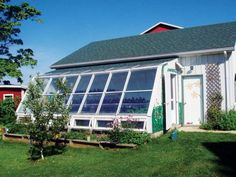 greenhouses using scrap windows and doors heated with plastic milk cartons painted black