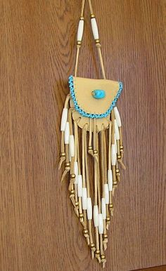 Cream deerskin medicine bag pouch with a turquoise stone, turquoise glass seed beads, fringe and hair bone beads