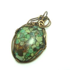 Wire Wrapped Pendant Chinese Turquoise Cabochon in Vintage Bronze. $20.00, via Etsy.