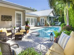 This pool and lanai is right out of a catalog - so pretty.  Olde Naples Beach house on Bougainvillea in Ridgeview Lakes   Olde Naples, Florida