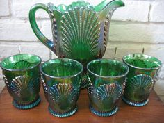 Vintage Moser Carnival Glass Pitcher and Glasses - Shell - Peacock. --100.00, via Etsy.