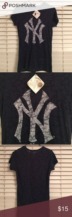 Women's New York Yankees T-Shirt - NWT New York Yankee's Genuine Merchandise T-Shirt - Bought it at a Yankees game and could never quite fit into it!  Measures 18 inches across the chest. Ladies cut - very cute!  Measures 27 inches from shoulder to bottom of shirt. Majestic Tops Tees - Short Sleeve