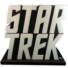 """Secure your favorite books or DVDs on your journey into space: the final frontier with these stylish Star Trek Logo Bookends by Icon Heroes. Together the two ends measure approximately 6.5"""" H x 7.25"""""""