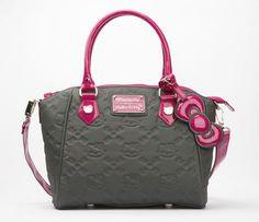 Hello Kitty Embossed Handbag: Plum $80 u.s. at sanrio.com so pretty....