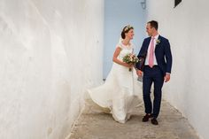 Happy Married Couple Walking On Streets Of Malaga Spain