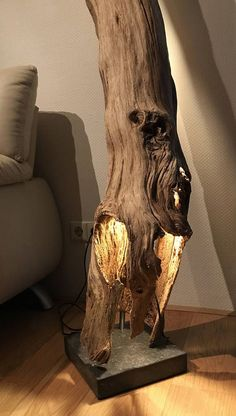 Floor lamp of weathered and old hollow Oakwood branch.