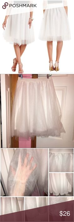 """White Tulle Full Midi Skirt Never worn and has been washed. Does have two marks on the waist line. (Paper airplanes are pointing to them in the photos.) 5 layers of tulle to create volume. Elastic waist. 100% polyester. Laying flat Approx 26"""" in length. Laying flat waist not stretched is 30"""" and can stretch up to 34"""". ❌NO TRADES❌ Charlotte Russe Skirts Midi"""