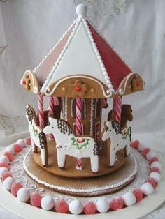 gingerbread carousel- yet more novel cake decorating ideas Gingerbread Village, Christmas Gingerbread House, Noel Christmas, Christmas Goodies, Gingerbread Man, Christmas Desserts, Holiday Treats, Christmas Treats, Gingerbread Cookies