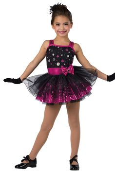 Style#17104 STOLE THE SHOW - FUCHSIA Glitter printed mesh over black spandex and metallic spandex leotard with attached black chiffon top skirt with fishing line curly hem. Separate sequined boucle over chiffon skirt. Bow trim. Headpiece included. XSC-XXLA G12-Short black gloves, optional.