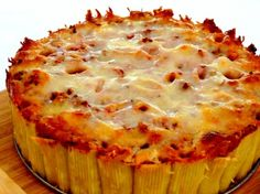 Rigatoni Pie ,  Your family is going to love this when you place it on the table on a cake pedestal with garlic bread and a salad.  It's different and fun.  ,