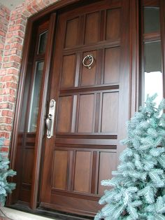 This is a close up of a #stunning #Amberwood #custom #mahogany #single #entry #door with 2 #glass #sidelights! Call (416-213-8007 or 1-800-861-3591) or come into #Amberwood's #outstanding #showroom #today!
