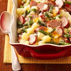 """Cheesy Brat Casserole: This six-ingredient hotdish recipe from an Appleton, Wisconsin, reader features an all-star lineup of Wisconsin foods, including bratwurst, cheddar cheese and potatoes. """"It's a quick, easy recipe,"""" our reader says. """"There's not much you can mess up."""""""
