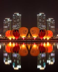 Such a stunning picture of hot air balloons in Daejon, Korea! #Orange #Reflections