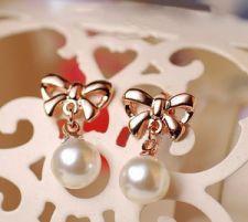 Bow pearl pendant earrings