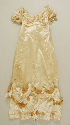 c. 1814 evening dress (front), French, made of silk The Metropolitan Museum of Art 11.60.216a, b - this dress has stunning decorations!