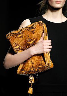 LV yellow snakeskin clutch bag