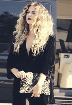 KO. Love the dark lips and wavy hair