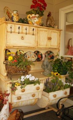 love the repurposing of an old hutch.      Forks and Spoons as handles and Drawers as planters!