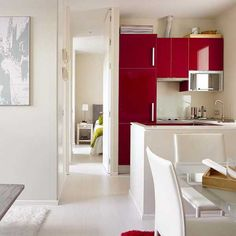 small kitchen with red cabinets