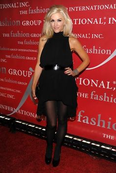 Gwen Stefani rocks this season's hottest fashion combination: thick black tights and a flowy dress.