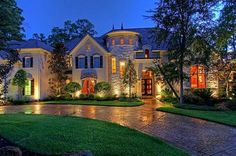 Absolutely Gorgeous! | 23 Glensheen Way, The Woodlands, TX | Stunning stone & stucco estate located in the prestigous manned-gated community of Carlton Woods features a wealth of convenient extras, such as double two-car garages, 2 bdrms down; wine room; custom Italian wall treatments; 3 studies; spacious master, surround sound, a whole-house generator. Kitchen is ready for entertaining. In home gym wired for cable. Backyard is private.