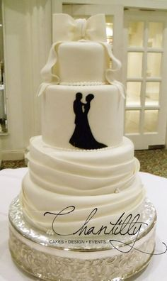 Chantilly - El-Paso-area Cakes - Four-tier wedding cake with fondant bow topper
